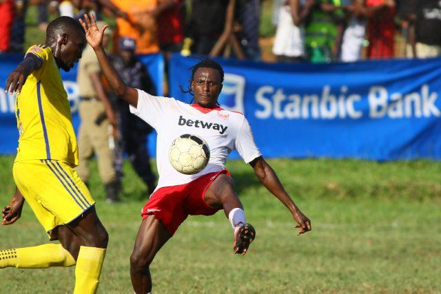 Micheal Birungi of Express (R) tries to control the ball against Bright Stars in Stanbic Uganda Cup semi final