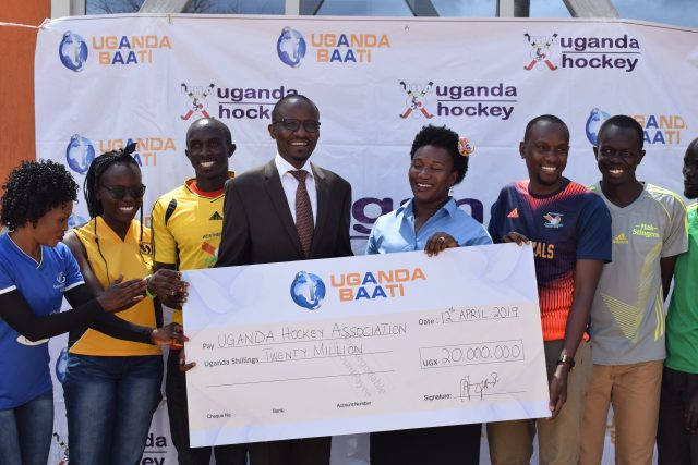 Uganda Baati's Arodi (M) with the cheque. next to him on right is UHA Chairperson Sanyu