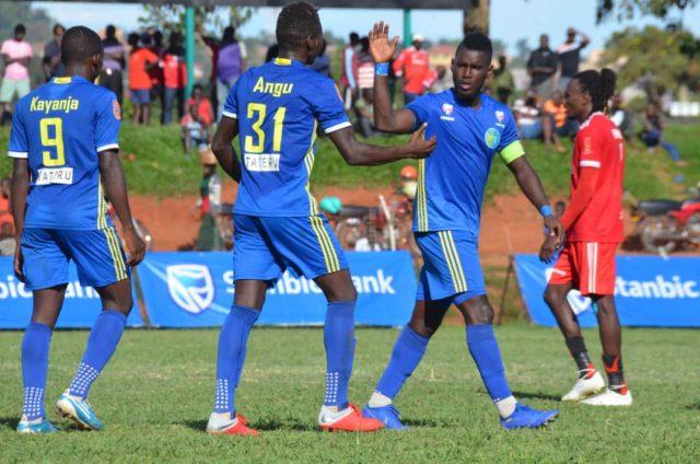 Angu James and Nelson Senkatuka celebrate Bright Stars equaliser against Express on Thrsday at Wankulukuku