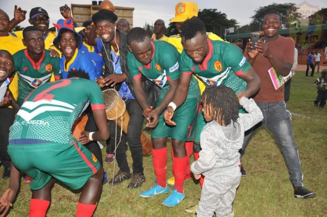 Some of the KCCA FC players celebrate with fans after the final whistle in Bombo against Ndejje University