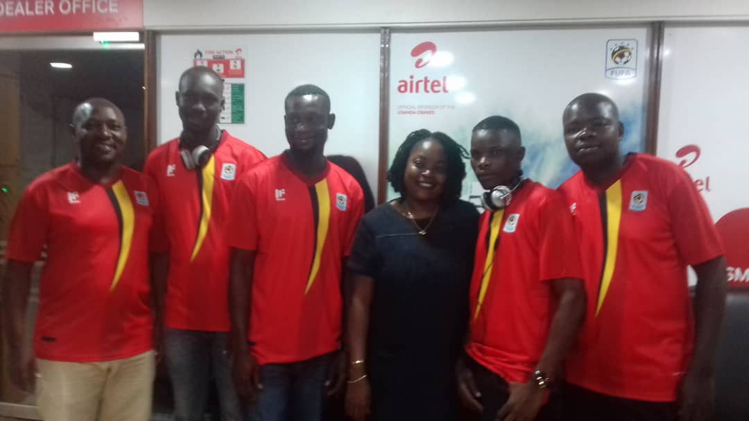 Kisakye (C) after briefing the lucky trip winners