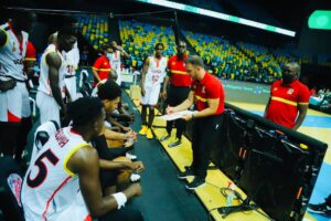 Coach George Galanopoulos in a time out talk with the players in a previous game. FIBA Photo